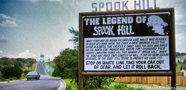 Roadside sign describing legend of spook hill
